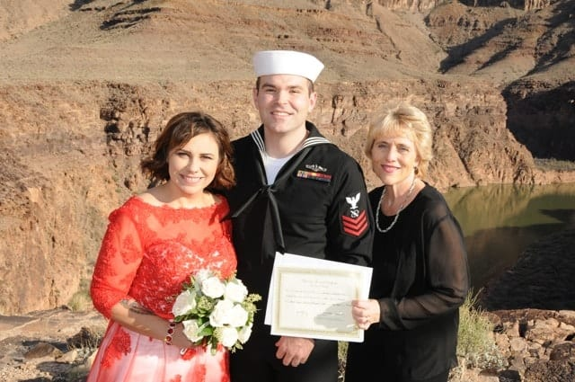 Couple with wedding vow renewal certificate
