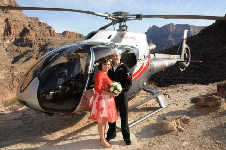 couple with Maverick helicopter at the Grand Canyon